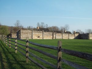 photo shows the lawn at fort roberdeau with its wooden fences