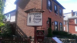 photo shows the welcome sign for the farnsworth house inn, it says farnsworth house dining, period fare spirits.